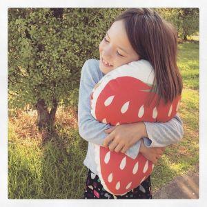 strawberry being cuddled